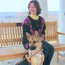 Sue Wiygul Martin and her guide dog, Kismet